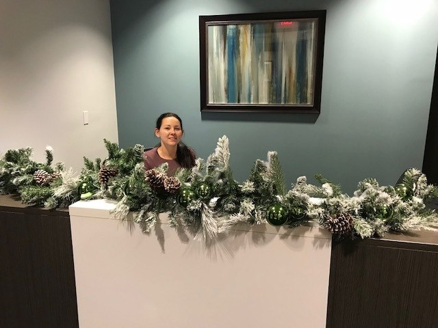 Anew University Naples Office - Madonna at front desk - garland on counter